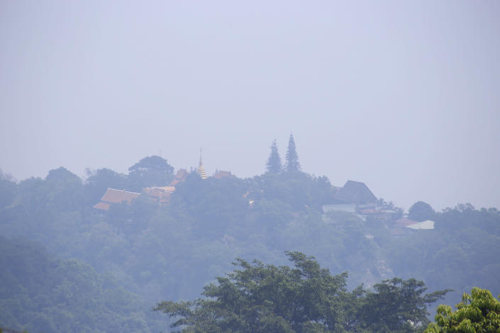 A thick layer of smog covers Wat Phra That Doi Suthep in Chiang Mai province, Thailand, Tuesday, April 2, 2019. The air hanging over Thailand's far north has become so polluted, the prime minister went Tuesday to see in person what's been called a severe health crisis. (AP Photo/Maytanan Merchant)