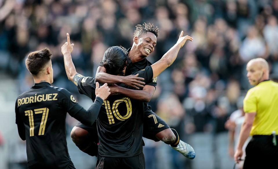 LOS ANGELES, CA - MARCH 01: Carlos Vela #10 of LAFC scores a goal and celebrates as teammate Latif Blessing #7 joins in on the fun during a game between Inter Miami CF and Los Angeles FC at Banc of California Stadium on March 01, 2020 in Los Angeles, California. (Photo by Michael Janosz/ISI Photos/Getty Images)
