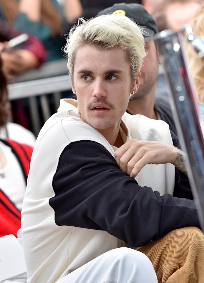 With Billy Idol hair and a Freddie Mercury 'stache, Bieber keeps the grooming surprises coming.