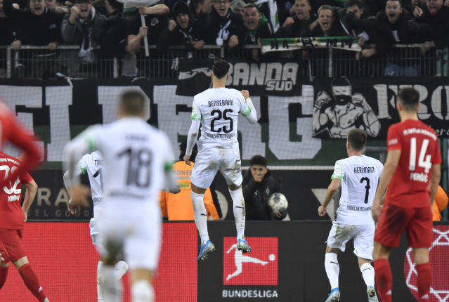 Moenchengladbach's Ramy Bensebaini celebrates after scoring his side's second goal during the German Bundesliga soccer match between Borussia Moenchengladbach and Bayern Munich at the Borussia Park in Moenchengladbach, Germany, Saturday, Dec. 7, 2019. (AP Photo/Martin Meissner)