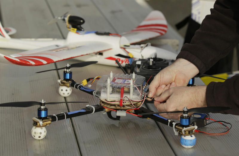 In this March, 28, 2012, photo, Mark Harrison prepares his Arcti Copter 5 drone for flight over a waterfront park in Berkeley, Calif. Interest in the domestic use of drones is surging among public agencies and private citizens alike, including a thriving subculture of amateur hobbyists, even as the prospect of countless tiny but powerful eyes circling in the skies raises serious privacy concerns. (AP Photo/Eric Risberg)