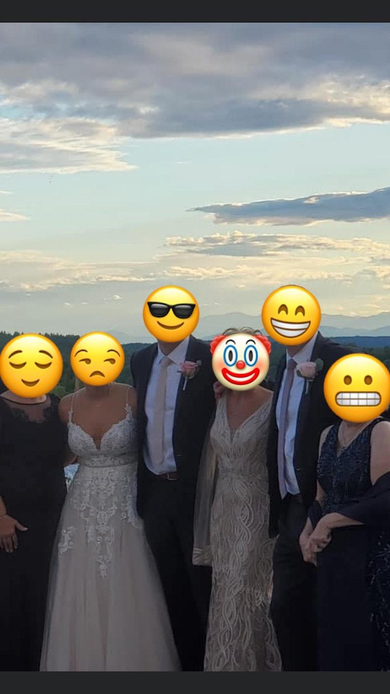 Bridal party with mother-in-law wearing a wedding dress