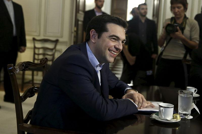 Greek PM Tsipras smiles during a meeting with Iranian Foreign Minister Zarif in Athens