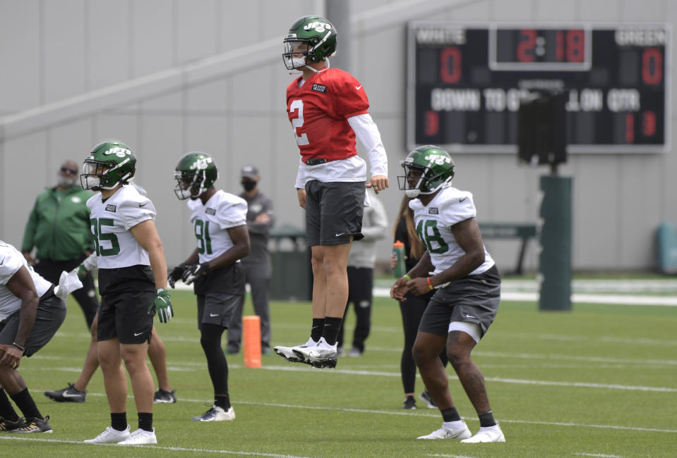 New York Jets first round draft pick Zach Wilson (2) works out during NFL football rookie camp, Friday, May 7, 2021, in Florham Park, N.J.(AP Photo/Bill Kostroun)
