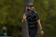Tommy Fleetwood, of England, waves to the gallery as he walks up the first fairway during the first round of the Masters golf tournament on Thursday, April 8, 2021, in Augusta, Ga. (AP Photo/Matt Slocum)