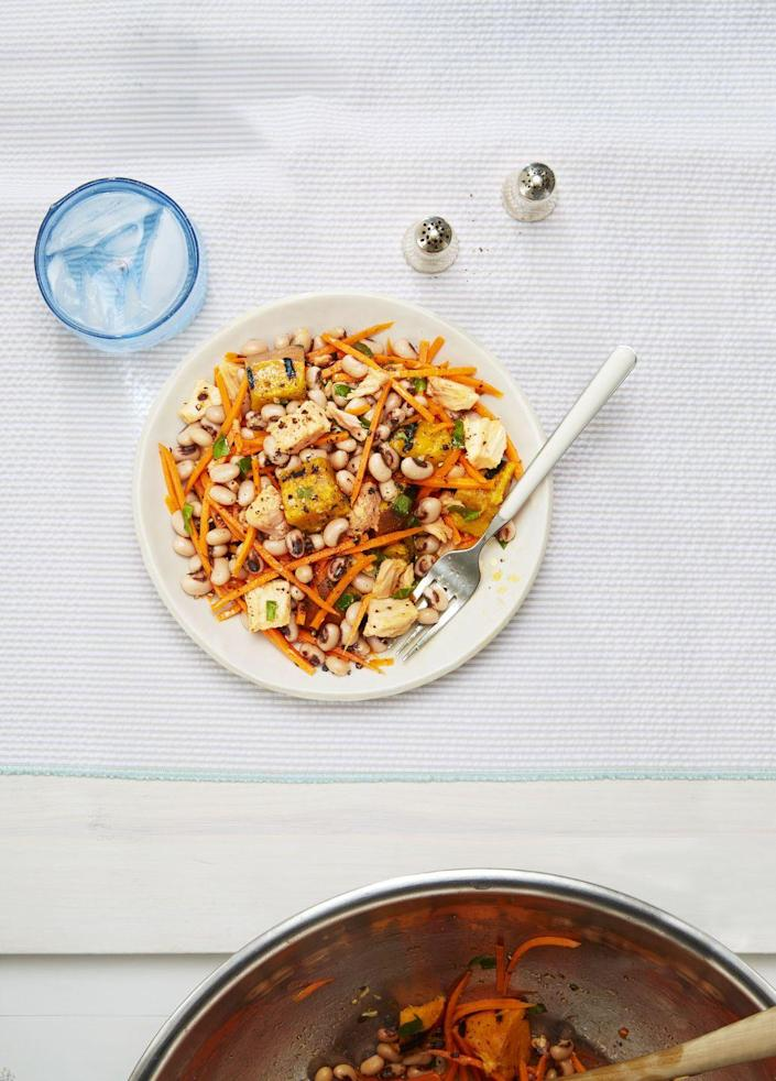 """<p>Bust out of your Caesar rut with this super satisfying salad. It's loaded with all the good stuff — grilled sweet potatoes, hearty black-eyed peas, crunchy carrots, and oil-packed tuna.</p><p><em><a href=""""https://www.goodhousekeeping.com/food-recipes/easy/a33583/summer-tuna-salad-with-sweet-potato-and-basil-recipe/"""" rel=""""nofollow noopener"""" target=""""_blank"""" data-ylk=""""slk:Get the recipe for Summer Tuna Salad »"""" class=""""link rapid-noclick-resp"""">Get the recipe for Summer Tuna Salad »</a></em> </p>"""