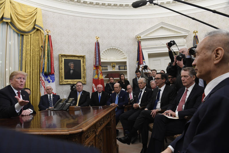 FILE - In this Jan. 31, 2019, file photo, President Donald Trump, left, holds a meeting with Chinese Vice Premier Liu He, right, in the Oval Office of the White House in Washington. Also attending the meeting, starting third from left seated, are, Vice President Mike Pence, Secretary of State Mike Pompeo, Agriculture Secretary Sonny Purdue, Commerce Secretary Wilbur Ross, White House economic adviser Larry Kudlow, White House trade adviser Peter Navarro, national security adviser John Bolton, Treasury Secretary Steven Mnuchin, and U.S. Trade Representative Robert Lighthizer. Where past presidents have relied on top academics, business leaders and officials with experience in prior administrations, Trump has gone a different route. He's built crew of camera-ready economic advisers, rather than one known for its policy chops. (AP Photo/Susan Walsh, File)