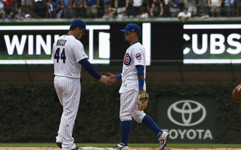 Chicago Cubs first baseman Anthony Rizzo (44) and shortstop Javier Baez celebrate their win over the San Diego Padres in a baseball game, Friday, July,19, 2019, in Chicago. (AP Photo/David Banks)