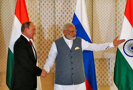 India's Prime Minister Narendra Modi (R) shakes hand with Russian President Vladimir Putin during a photo opportunity ahead of India-Russia Annual Summit in Benaulim, in the western state of Goa, India, October 15, 2016. REUTERS/Danish Siddiqui