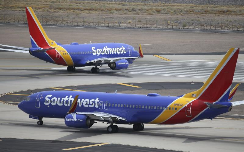 FILE - This July 17, 2019 photo shows Southwest Airlines planes at Phoenix Sky Harbor International Airport in Phoenix. Southwest Airlines Co. reports financial earns on Thursday, Oct. 24. (AP Photo/Ross D. Franklin, File)