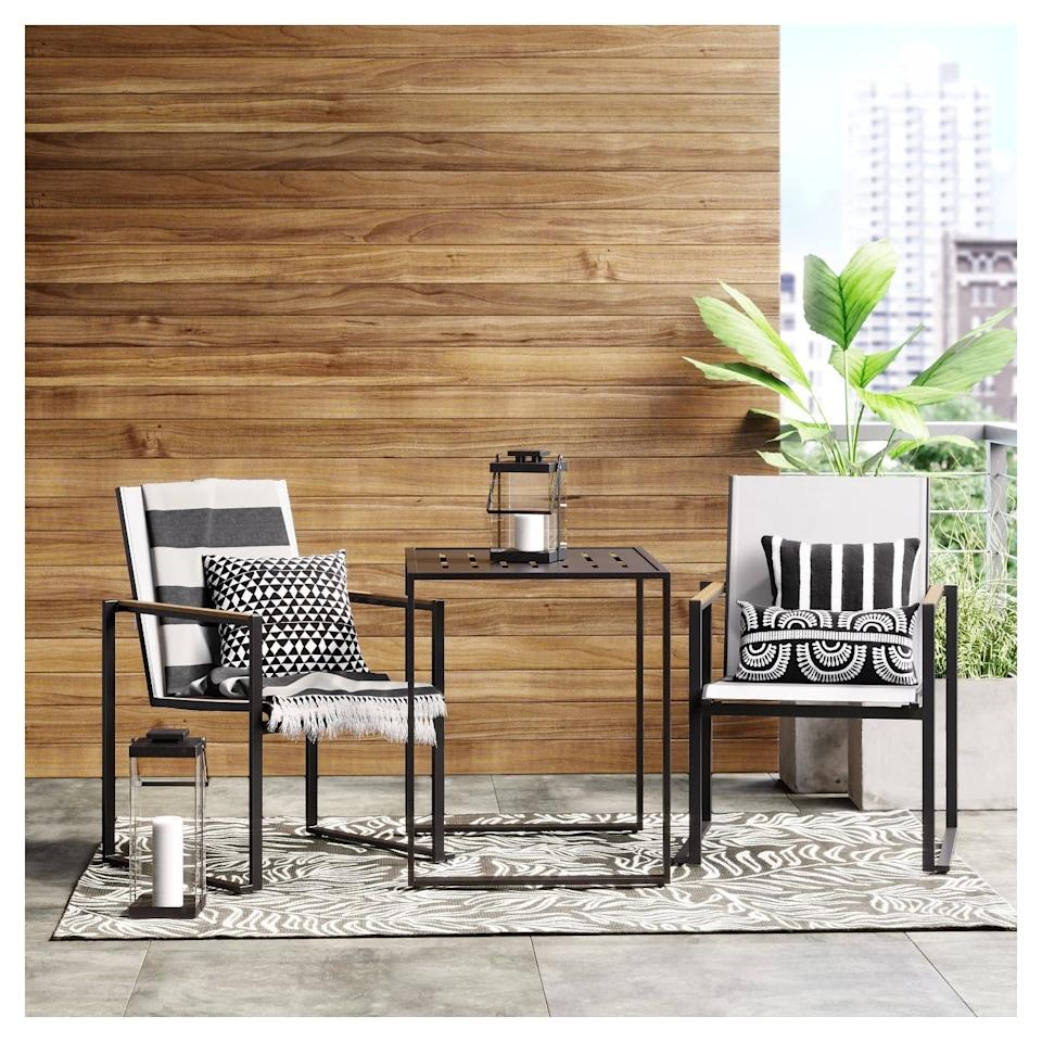 """<p>The <a href=""""https://www.popsugar.com/buy/Henning-Patio-Bistro-Set-430156?p_name=Henning%20Patio%20Bistro%20Set&retailer=target.com&pid=430156&price=300&evar1=casa%3Aus&evar9=46144610&evar98=https%3A%2F%2Fwww.popsugar.com%2Fhome%2Fphoto-gallery%2F46144610%2Fimage%2F46144618%2FHenning-Patio-Bistro-Set&list1=shopping%2Ctarget%2Csmall%20spaces%2Csmall%20space%20living%2Capartment%20living%2Coutdoor%20decorating%2Caffordable%20decor%2Chome%20shopping&prop13=api&pdata=1"""" rel=""""nofollow"""" data-shoppable-link=""""1"""" target=""""_blank"""" class=""""ga-track"""" data-ga-category=""""Related"""" data-ga-label=""""https://www.target.com/p/henning-3pc-patio-bistro-set-off-white-project-62-153/-/A-52616298"""" data-ga-action=""""In-Line Links"""">Henning Patio Bistro Set</a> ($300) creates the illusion of an open, airy space thanks to the amount of light that's able to pass through its chair and table's sleek frame.</p>"""
