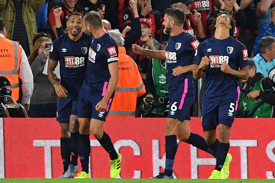 Bournemouth's English striker Callum Wilson (L) celebrates with teammates after scoring their late third goal during the English Premier League football match between Southampton and Bournemouth at St Mary's Stadium in Southampton, southern England on September 20, 2019. - Bournemouth won the game 3-1. (Photo by OLLY GREENWOOD / AFP) / RESTRICTED TO EDITORIAL USE. No use with unauthorized audio, video, data, fixture lists, club/league logos or 'live' services. Online in-match use limited to 120 images. An additional 40 images may be used in extra time. No video emulation. Social media in-match use limited to 120 images. An additional 40 images may be used in extra time. No use in betting publications, games or single club/league/player publications. /         (Photo credit should read OLLY GREENWOOD/AFP/Getty Images)
