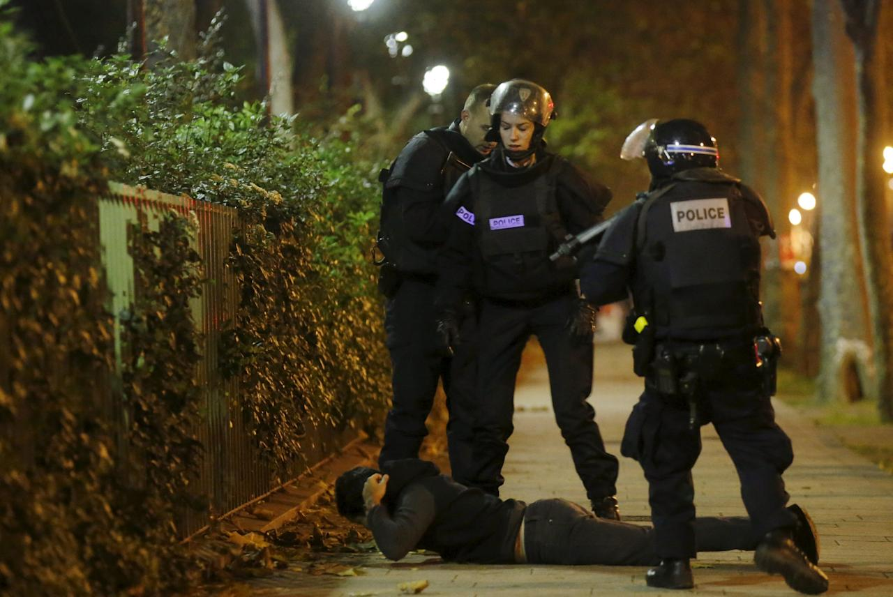 A man lies on the ground as French police check his identity near the Bataclan concert hall following fatal shootings in Paris, France, November 13, 2015. The man was later released after his identity was verified.    REUTERS/Christian Hartmann      TPX IMAGES OF THE DAY
