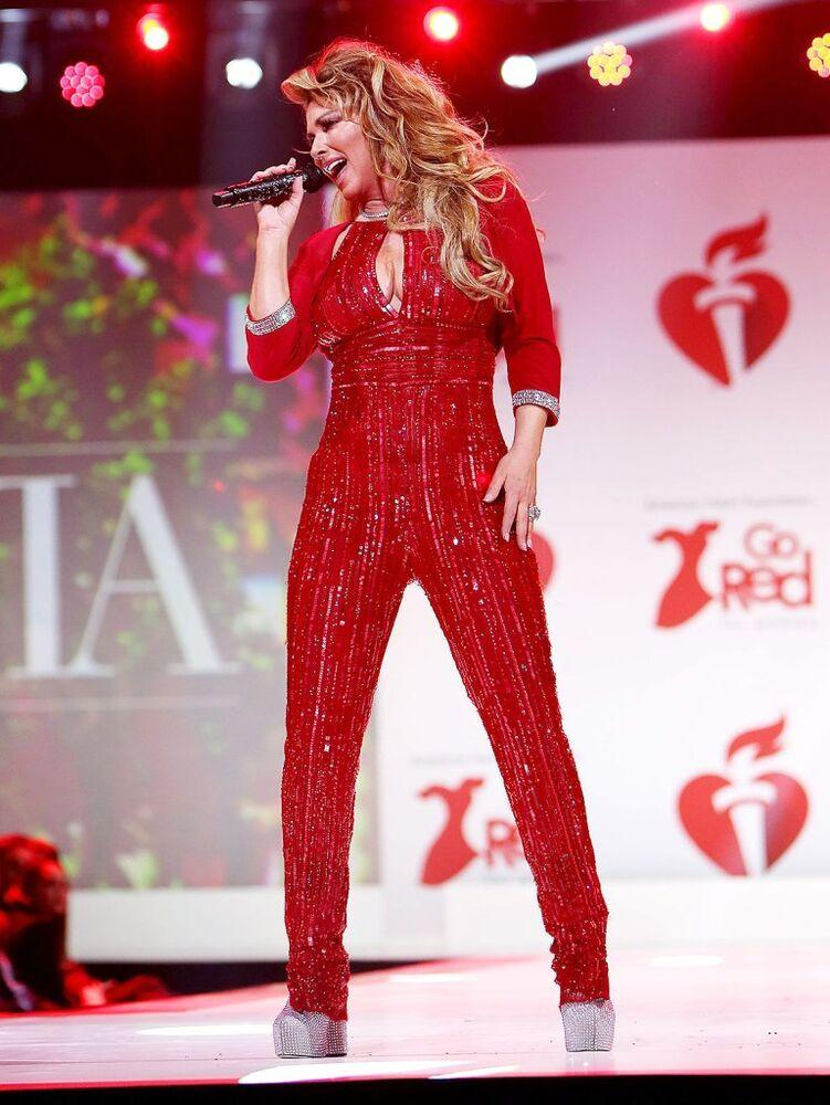 Shania Twain performing at the American Heart Association's Go Red For Women Red Dress Collection fashion show | Patrick Lewis/Starpix/Shutterstock