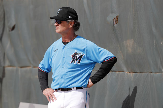 Miami Marlins manager Don Mattingly watches his team during spring training baseball practice Wednesday, Feb. 12, 2020, in Jupiter, Fla. (AP Photo/Jeff Roberson)