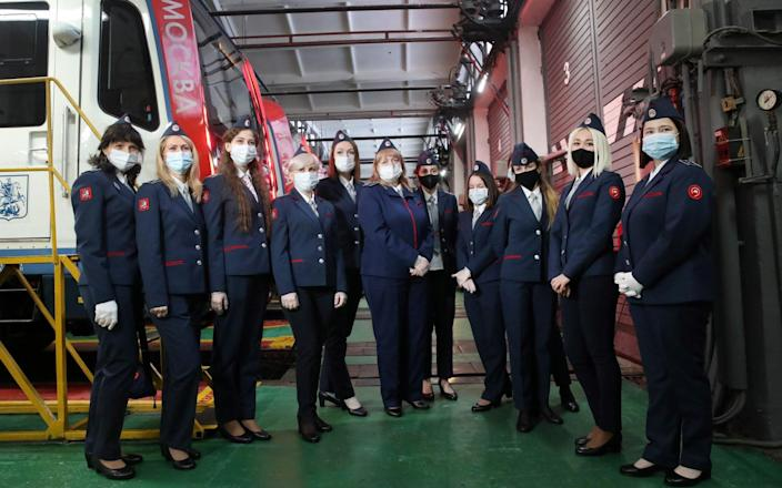 Female train drivers pose for a group photograph - Vyacheslav Prokofyev\\TASS via Getty Images