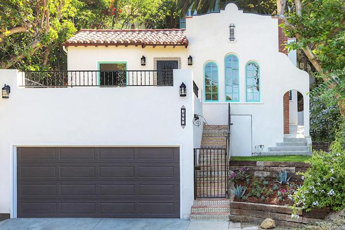 <p>One look at this beautiful Spanish Revival in the hip Los Feliz neighborhood of L.A., and you'd never know that the roof once had holes, garbage had been piled to the ceiling and the bathtub had fallen through the floor.<i> (Photo: Charmaine David for Kenihan Development)</i><br></p>