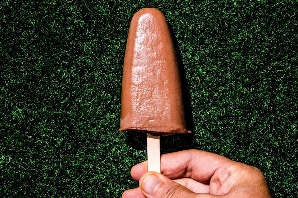 """This delicious 'fudgsicle' recipe basically produces really fudgy chocolate ice cream...on a stick. <a href=""""https://www.bonappetit.com/recipe/fudgsicle-popsicle-recipe?mbid=synd_yahoo_rss"""" rel=""""nofollow noopener"""" target=""""_blank"""" data-ylk=""""slk:See recipe."""" class=""""link rapid-noclick-resp"""">See recipe.</a>"""