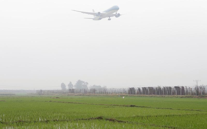 A plane prepares to land at Nội Bài International Airport - Credit: Reuters