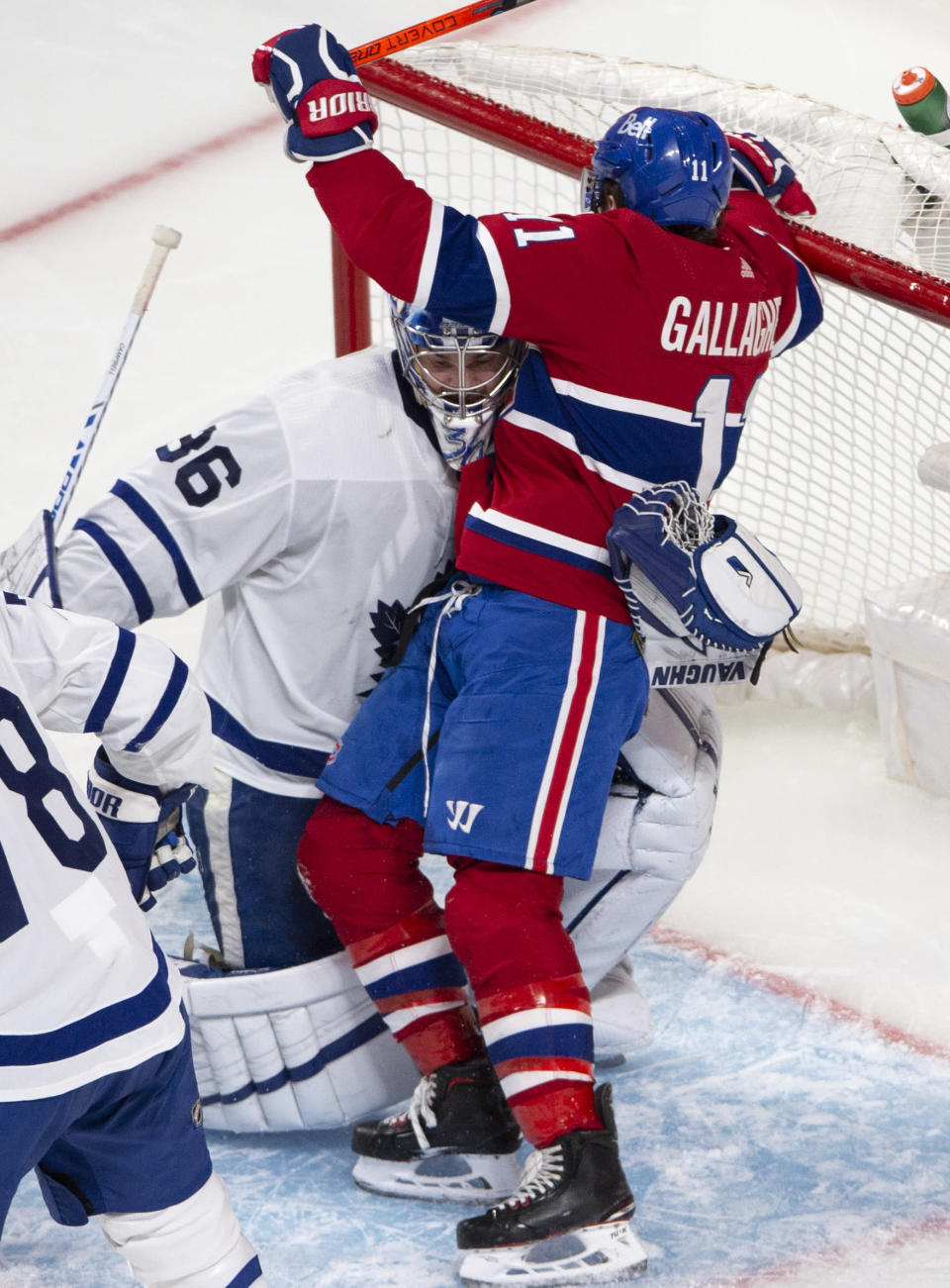 Montreal Canadiens right wing Brendan Gallagher (11) becomes entangled with Toronto Maple Leafs goaltender Jack Campbell (36) during the second period of Game 6 of an NHL hockey Stanley Cup first-round playoff seres Saturday, May 29, 2021, in Montreal. (Ryan Remiorz/The Canadian Press via AP