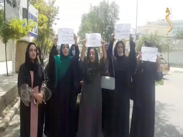 A group of Afghan women holding a street protest calling on the Taliban to protect their rights (Photo Credit - Reuters)