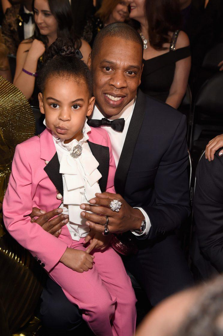 Blue Ivy Carter and Jay Z at the 59th Grammy Awards in Los Angeles. (Photo by Kevin Mazur/Getty Images for NARAS)
