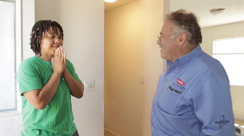 Habitat for Humanity homeowner Tamara reacts after David Kahn of Kahn Air turns on her new Carrier ductless home comfort system. Carrier donated more than 150 ductless heat pumps to Habitat for Humanity of Los Angeles as part of a donation of more than 500 systems to Habitat this year.