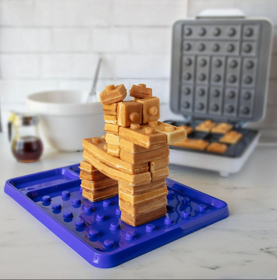 """If you're one of the millions of people who couldn't decide whether to eat waffles or Legos for breakfast, <a href=""""https://www.waffle-wow.com/building-bricks"""" target=""""_blank"""" rel=""""noopener noreferrer"""">this waffle maker </a>will be a godsend. It creates building bricks of different sizes, allowing you to make the waffle sculpture of your dreams."""