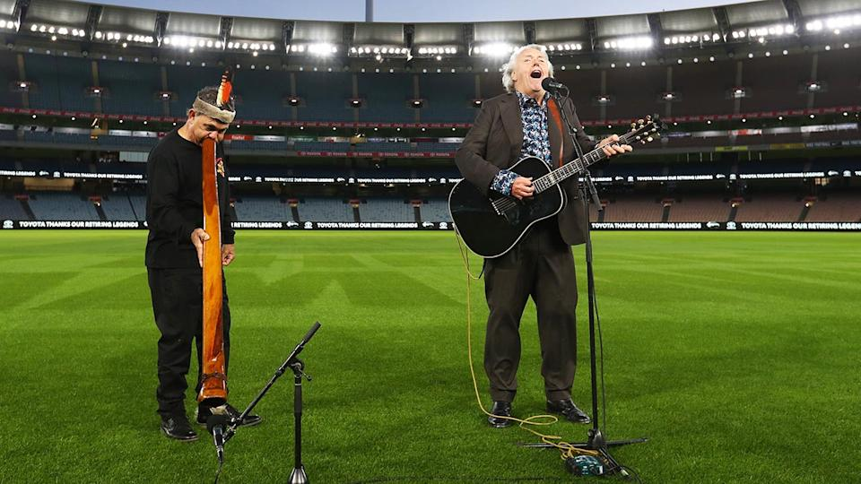 Mike Brady and Ron Murray, pictured here perform as part of the AFL Grand Final entertainment at the MCG..