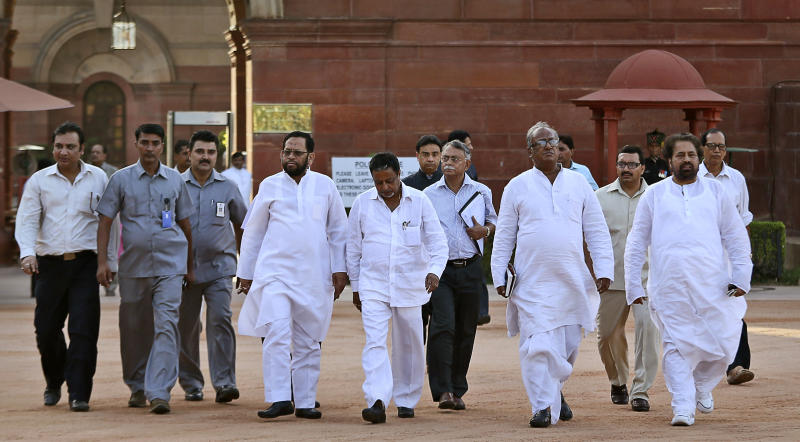 Trinamool Congress party lawmakers walk out of the presidential palace after submitting a letter withdrawing their party's support to the ruling coalition, in New Delhi, India , Friday, Sept. 21, 2012. Indian Prime Minister Manmohan Singh's coalition has splintered after the Trinamool Congress party pulled out of the coalition protesting the decision to allow foreign retail chains to come into the country. (AP Photo/Manish Swarup)