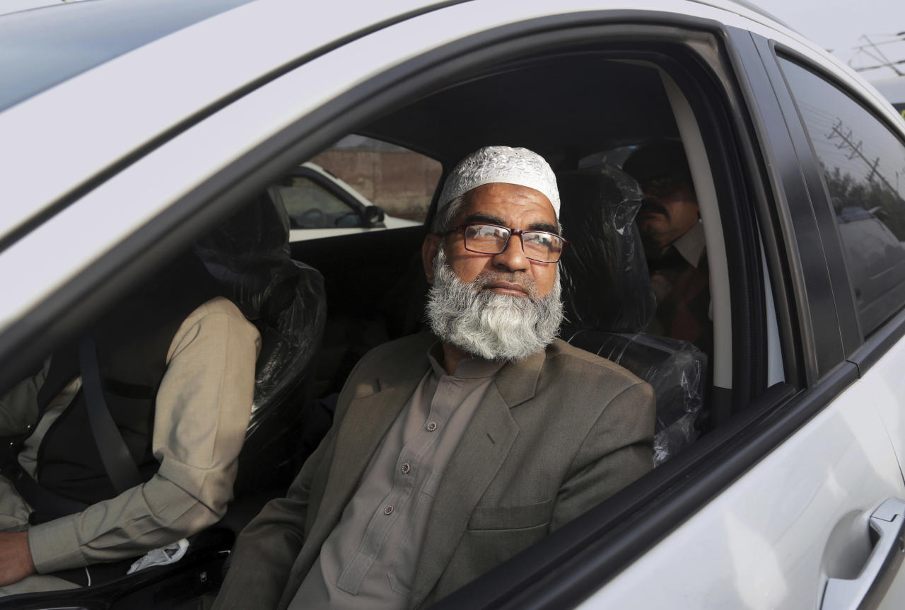 Mohammed Amin, father of seven year-old girl Zainab Ansari, leaves following the court verdict, in Lahore, Pakistan, Saturday, Feb. 17, 2018. A public prosecutor in Pakistan says a court has sentenced a serial killer to death after finding him guilty of killing eight children, including a 7-year-old girl whose rape and murder drew nationwide condemnation. (AP Photo/K.M. Chaudary)