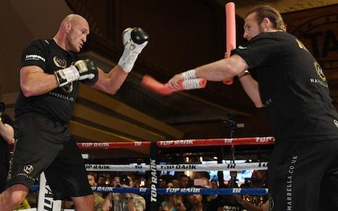 Boxer Tyson Fury (L) works out with his trainer Ben Davison - Credit: GETTY IMAGES