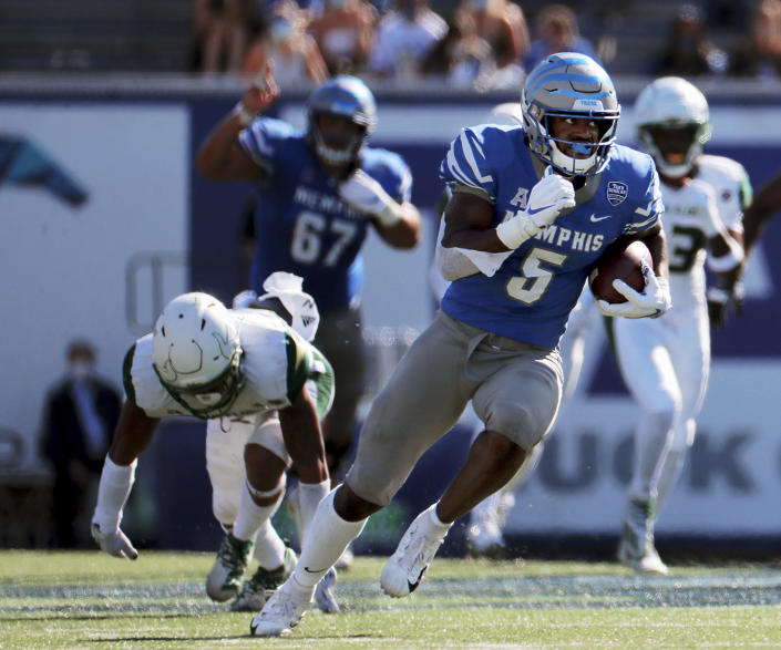 Memphis tight end Sean Dykes (5) breaks away from a tackle during the second quarter of an NCAA college football game against South Florida, Saturday, Nov. 7, 2020, in Memphis, Tenn. (Patrick Lantrip/Daily Memphian via AP)