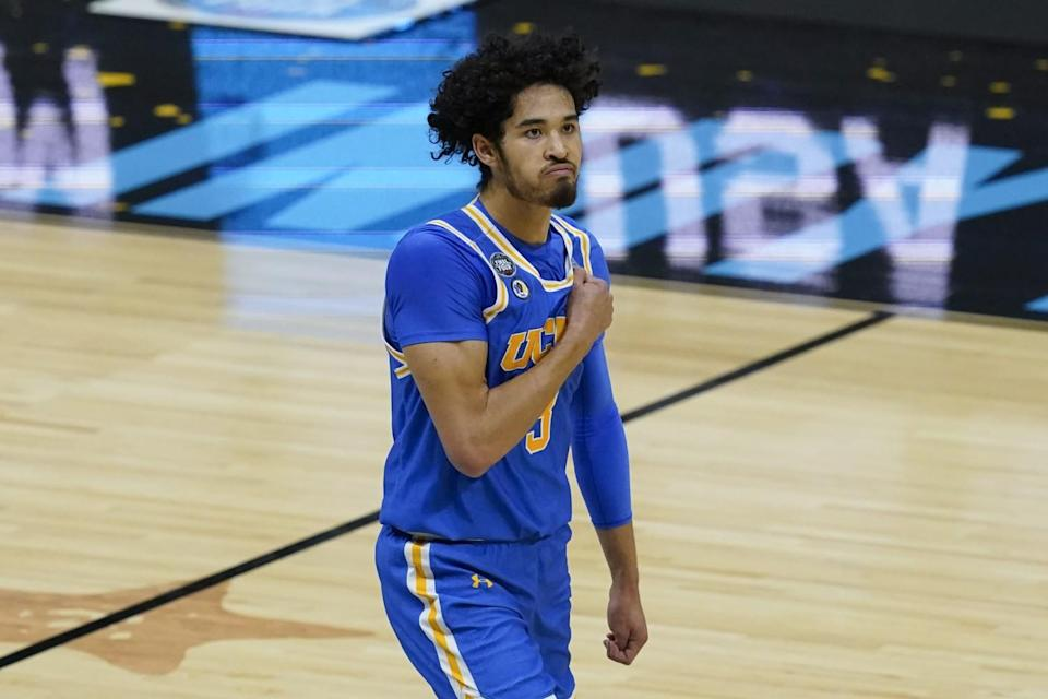 UCLA guard Johnny Juzang reacts after making a basket during the first half.