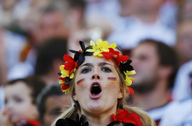 A fan of Germany waits for the start of their 2014 World Cup final against Argentina at the Maracana stadium in Rio de Janeiro July 13, 2014. REUTERS/Damir Sagolj (BRAZIL - Tags: SOCCER SPORT WORLD CUP)
