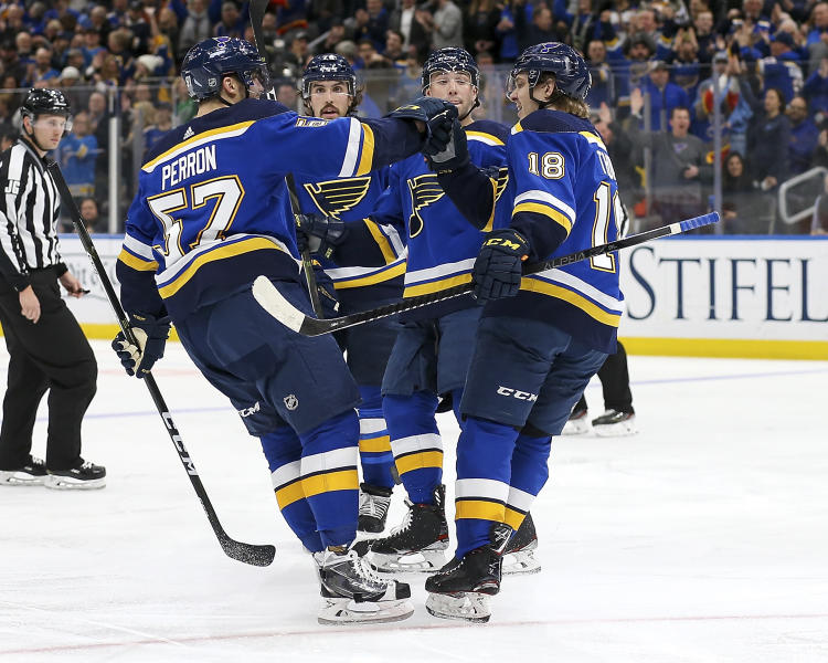 St. Louis Blues' Robert Thomas (18), right, is congratulated by teammate David Perron (57) after scoring a goal during the second period of an NHL hockey game against the Chicago Blackhawks Tuesday Feb. 25, 2020, in St. Louis. (AP Photo/Scott Kane)