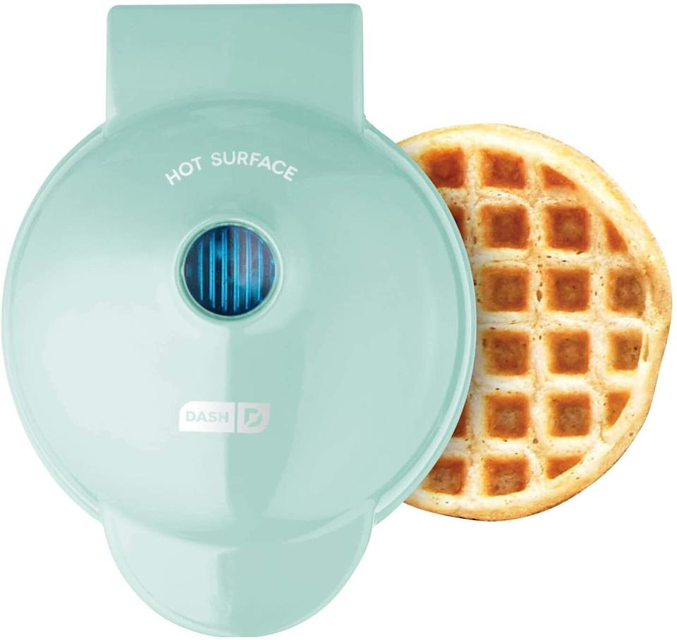 """You'll quickly put IHOP to shame when you churn out adorably sized, perfectly cooked waffles in this little machine. Plus, you can make hash browns, paninis, biscuits and even (gasp) PIZZA.<br /><br />P.S. Here's a whole slew of inspo from an article on<a href=""""https://www.buzzfeed.com/emofly/foods-you-can-make-in-a-waffle-iron"""">surprising things you can make in a waffle maker</a>(<strong>waffled tomato grilled cheese,</strong>y'all) if you need some boredom busters to get you started.<br /><br /><strong>Promising review:</strong>""""YES! Tiny Eggo-sized waffles! Put anything into it —<strong>hash browns, tater tots, waffle mix, canned biscuits!</strong>Add nuts and berries and things! It even<strong>comes with a little recipe booklet!</strong>It fits in the palm of your hand, you could literally stuff it in the back of a drawer, but you won't, because as soon as you get it everyone wants mini waffles for every meal.<strong>It heats up super fast and is a breeze to clean.</strong>If you're making a whole mess of waffles, be sure to give it a quick spritz of nonstick spray every couple waffles or so, so it doesn't rend your delicious waffles asunder. Excellent value."""" —<a href=""""https://www.amazon.com/gp/customer-reviews/R1R1QMQGCL7S3H?ASIN=B01M9I779L&ie=UTF8&linkCode=ll2&tag=huffpost-bfsyndication-20&linkId=1a68b5b306a4c52f84011a47ef94d05a&language=en_US&ref_=as_li_ss_tl"""" target=""""_blank"""" rel=""""noopener noreferrer"""">Bryce Pierce</a><br /><br /><strong>Get it from Amazon for<a href=""""https://www.amazon.com/Dash-Mini-Maker-Individual-Breakfast/dp/B01M9I779L?&linkCode=ll1&tag=huffpost-bfsyndication-20&linkId=506a5f855fca1cac5ae6efac47f9deda&language=en_US&ref_=as_li_ss_tl"""" target=""""_blank"""" rel=""""noopener noreferrer"""">$9.99</a>(available in 19 colors and waffle shapes).<br /></strong>"""