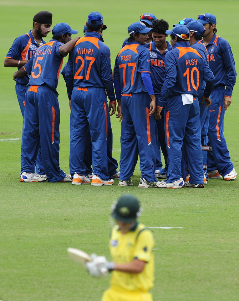 TOWNSVILLE, AUSTRALIA - AUGUST 26:  The Indian team celebrate the dismissal of Meyrick Buchanan of Australia during the 2012 ICC U19 Cricket World Cup Final between Australia and India at Tony Ireland Stadium on August 26, 2012 in Townsville, Australia.  (Photo by Ian Hitchcock-ICC/Getty Images)