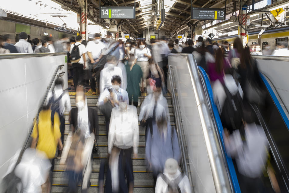 Commuters move along a crowded train station platform in Tokyo Friday, Oct. 8, 2021, the morning after a strongearthquake has shaken the Tokyo area Thursday night, temporarily halting trains and subways. (AP Photo/Kiichiro Sato)
