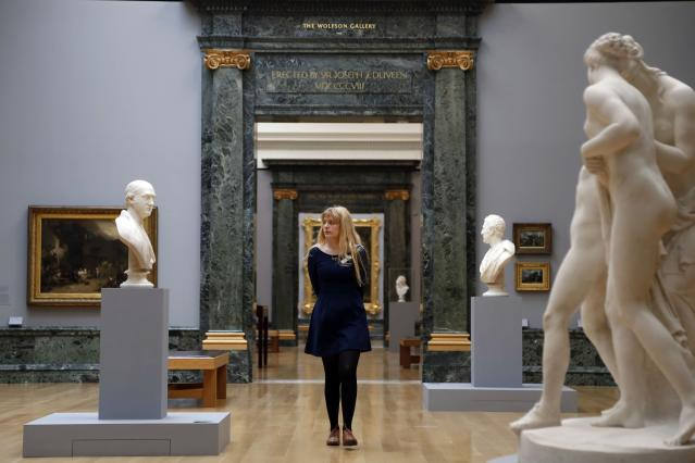 LONDON, UNITED KINGDOM - MAY 13: A woman admires artwork on display at the Walk through British Art exhibition at Tate Britain on May 13, 2013 in London, England. Visitors will experience a completely new presentation of the world's greatest collection of British art, the national collection of British art will be displayed in a continuous and purely chronological display from the 1500s to the present day. (Photo by Warrick Page/Getty Images)