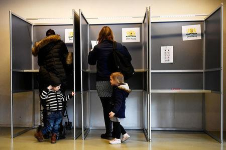 People vote during the general election in The Hague