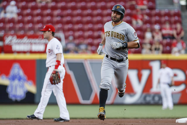 Pittsburgh Pirates' Francisco Cervelli runs the bases after hitting a two-run home run off Cincinnati Reds starting pitcher Homer Bailey during the first inning of a baseball game Wednesday, May 23, 2018, in Cincinnati. (AP Photo/John Minchillo)