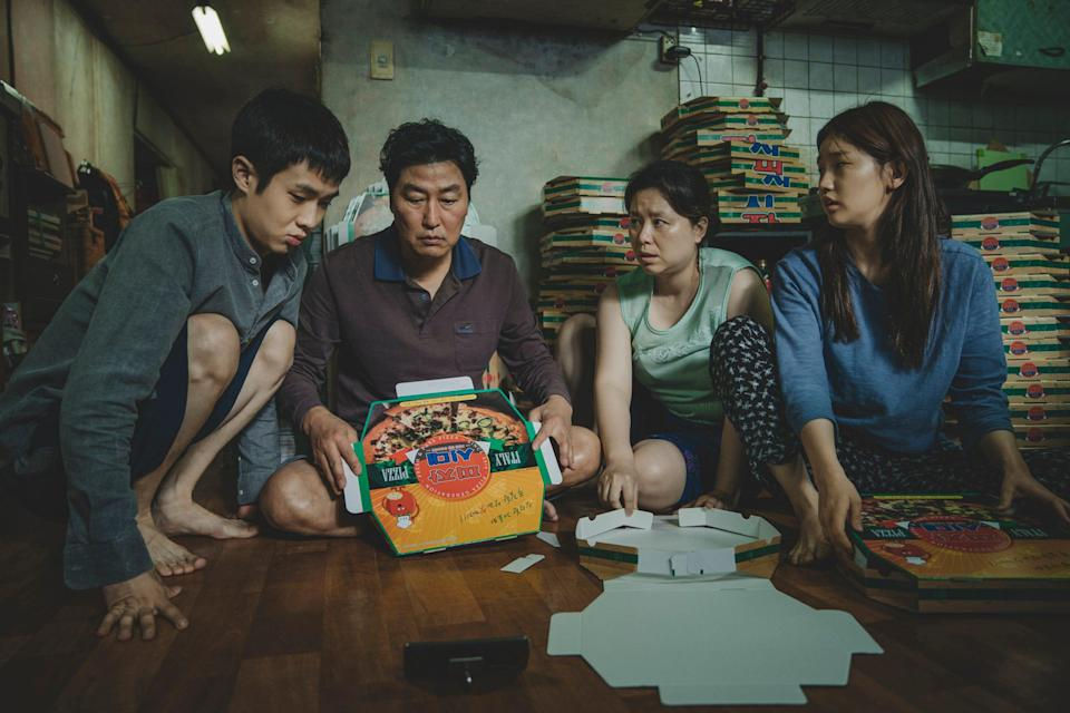 "Choi Woo-shik (from left), Song Kang-ho, Jang Hye-jin and Park So-dam star as a scheming South Korean family in the black comedy ""Parasite."""