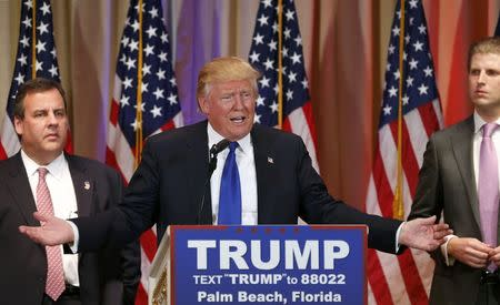 Republican U.S. presidential candidate Donald Trump speaks about the results of Super Tuesday primary and caucus voting as former rival Christie and his son Eric look on during a news conference in Palm Beach