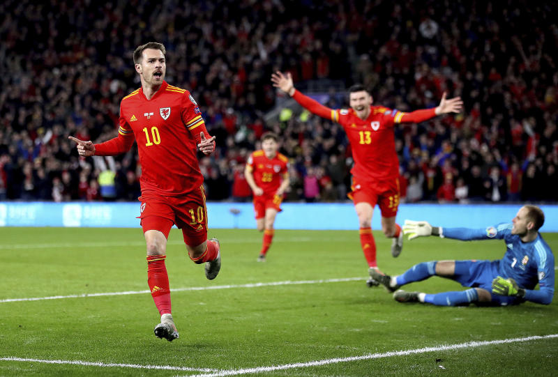 Wales' Aaron Ramsey celebrates scoring his side's first goal of the game against Hungary during their UEFA Euro 2020 Qualifying soccer match at the Cardiff City Stadium, in Cardiff, Wales, Tuesday Nov. 19, 2019. (Nick Potts/PA via AP)
