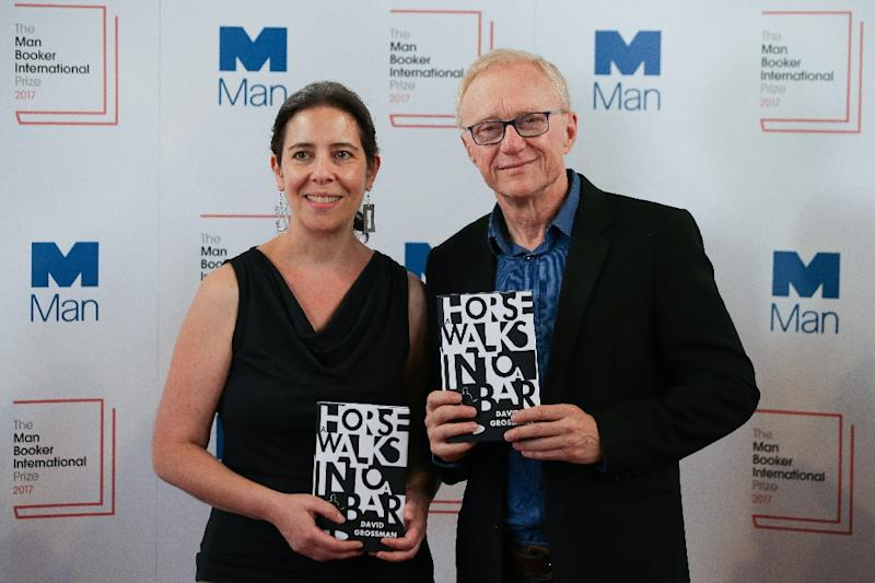 """US translator Jessica Cohen (L) and Israeli author David Grossman (R) pose for a photograph with his book """"A Horse Walks Into a Bar"""" which won the Man Booker International Prize in London on June 13, 2017"""