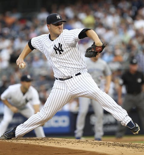 New York Yankees starting pitcher Phil Hughes pitches during the second inning of the baseball game Monday, July 16, 2012 at Yankee Stadium in New York. (AP Photo/Seth Wenig)