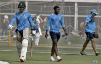 South Africa's Dean Elgar, left, and Lutho Sipamla, center, attend a practice session at the National Cricket Stadium, in Karachi, Pakistan, Saturday, Jan. 23, 2021. South Africa, which arrived in the southern port city of Karachi for the first time in nearly 14 years, will play the first cricket test match against Pakistan starting on Jan. 26. (AP Photo/Fareed Khan)