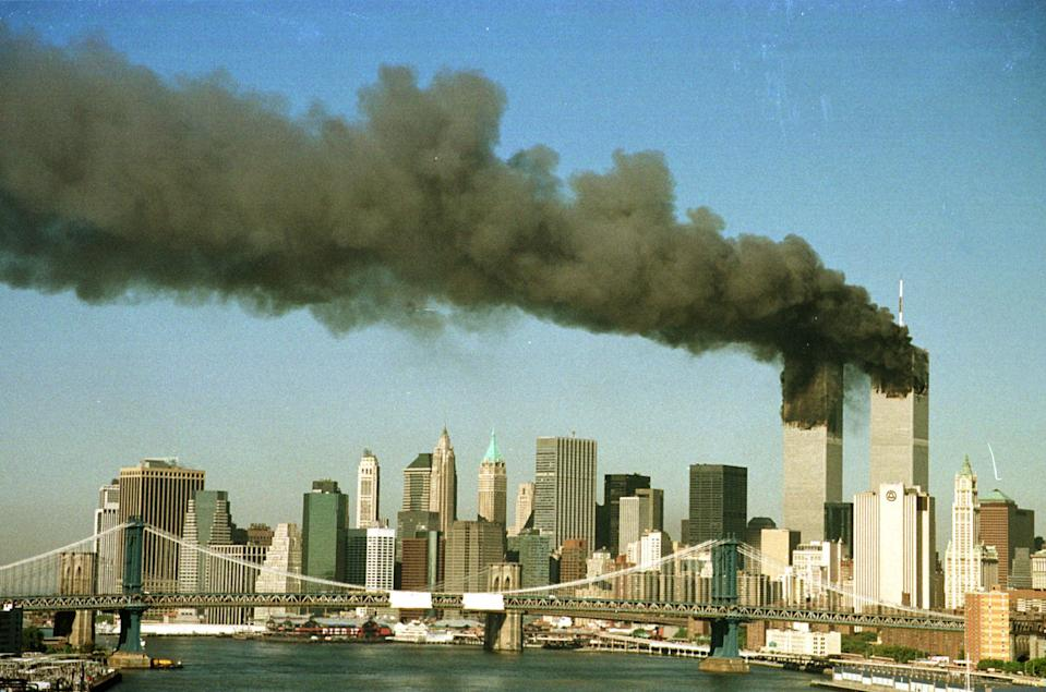 <p>The towers of the World Trade Center pour smoke shortly after being struck by hijacked commercial airplanes in New York. (Reuters)</p>