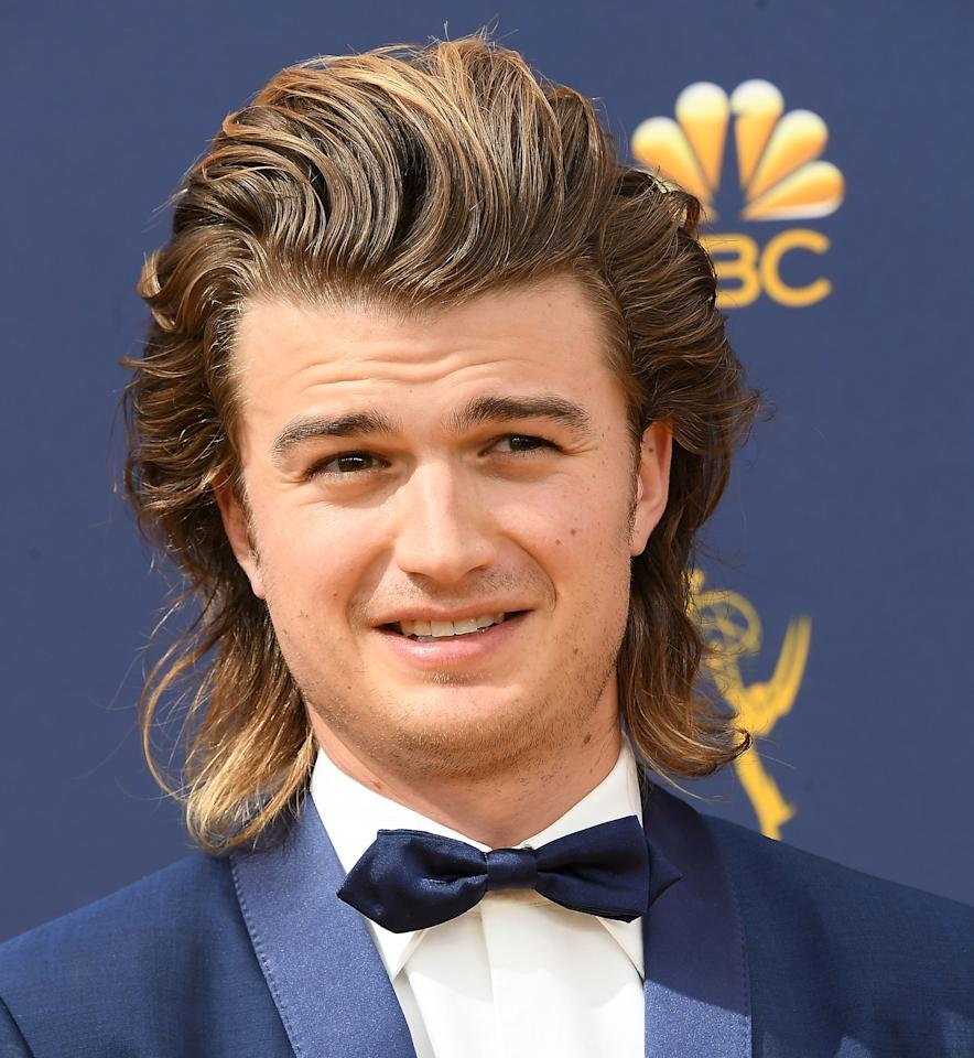 """Joe Keery, meanwhile, managed to make his epic flow even more attention-grabbing by showing up to the Emmys with what appeared to be blonde highlights. Now his mullet is lingering somewhere between """"lion's mane"""" and """"Andre Agassi at his hair prime"""" which, all things considered, is a pretty epic grooming Venn diagram to land on."""